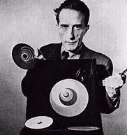 Marcel Duchamp, with rotoreliefs, a still from Hans Richter's film Dreams That Money Can Buy, 1947. Photo Arnold Eagle.